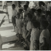 World War II. Malay. Civilian internees camp. Children choir.