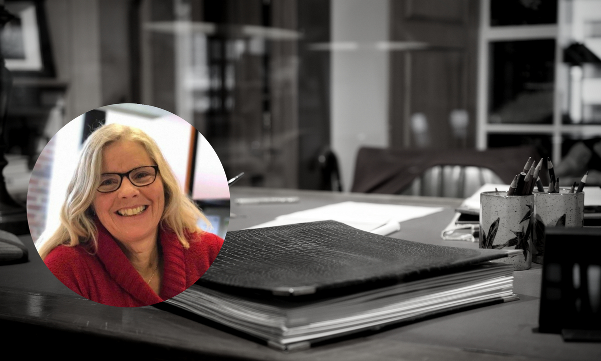 Photo of Margo Jeske, Director of the Brian Dickson Law Library superimposed over an image of an office desk.